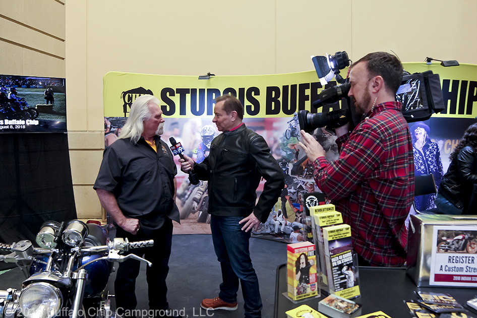 Crazy John Markwald interview with local media in the Sturgis Buffalo Chip display