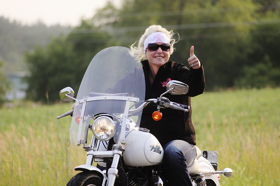 Malinda Johnson riding through Grand Rounds Scenic Byway in Minnesota