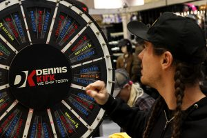 Show attendee tries his luck spinning the prize wheel in the Dennis Kirk booth at the 2019 Donnie Smith Bike & Car Show