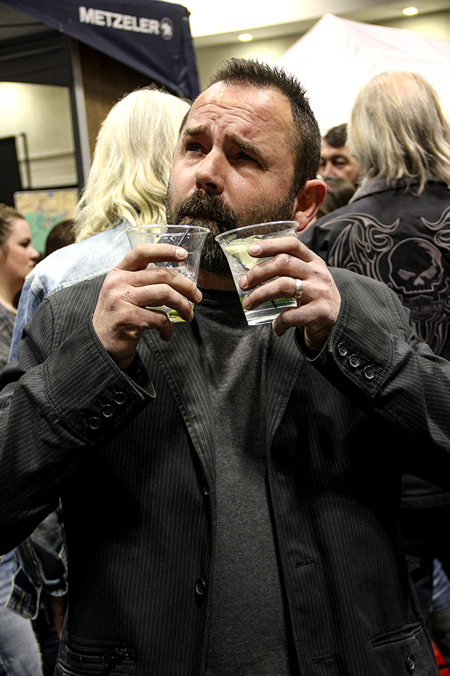 "Kevin ""Teach"" Baas celebrates a successful show during Happy Hour at the 2019 Donnie Smith Bike & Car Show"