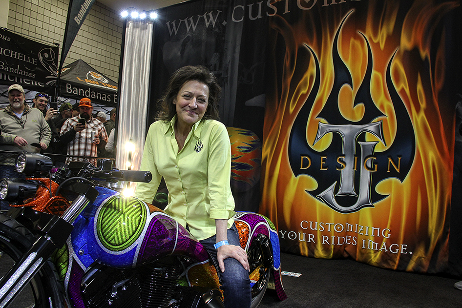 Lizzy Hilgers sits on top of the custom Harley unveiled in the TJ Designs display at the Donnie Smith Bike and Car Show
