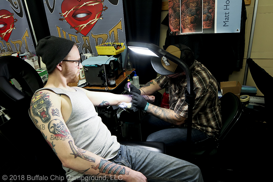 A man gets some fresh in at the Tattoo Expo.