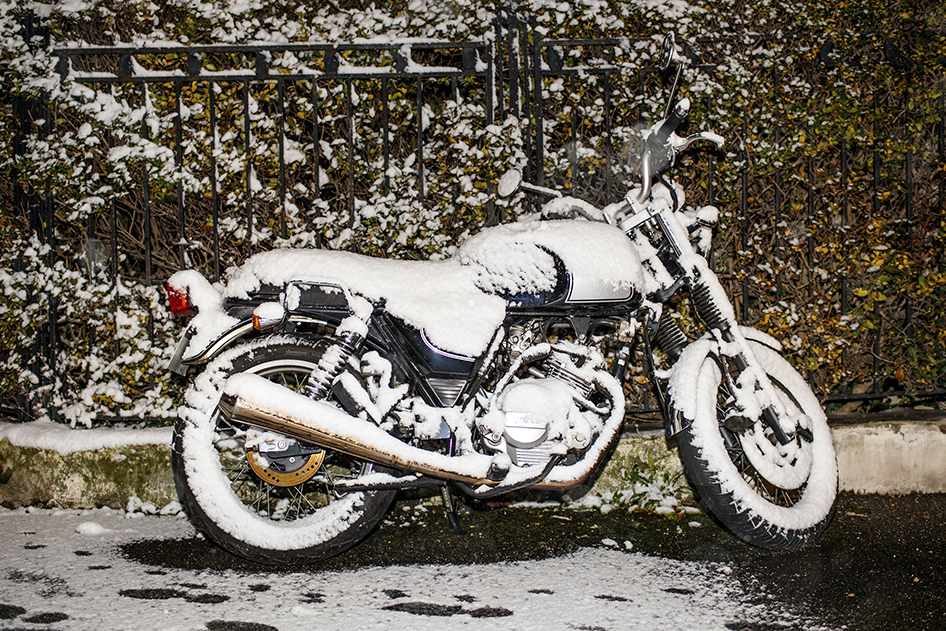 Snow Covered Motorcycle during a Minnesota Winter